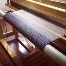 Weaving in progress on the rug loom; Photo and weaving by Amanda K Gross
