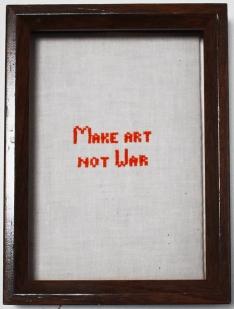 Make Art Not War: Hand cross stitch by Amanda K Gross
